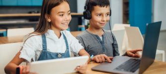 children_at_laptops_AdobeStock_325402962_credit_Тарас Нагирняк